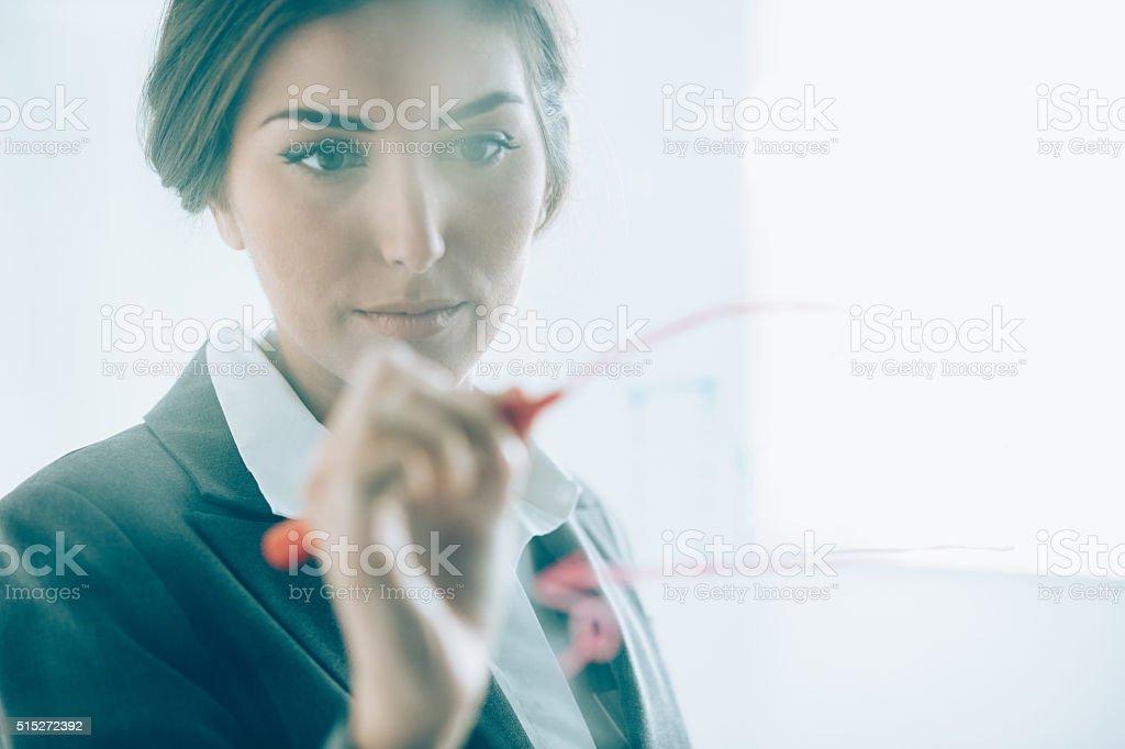 Businesswoman making presentation stock photo