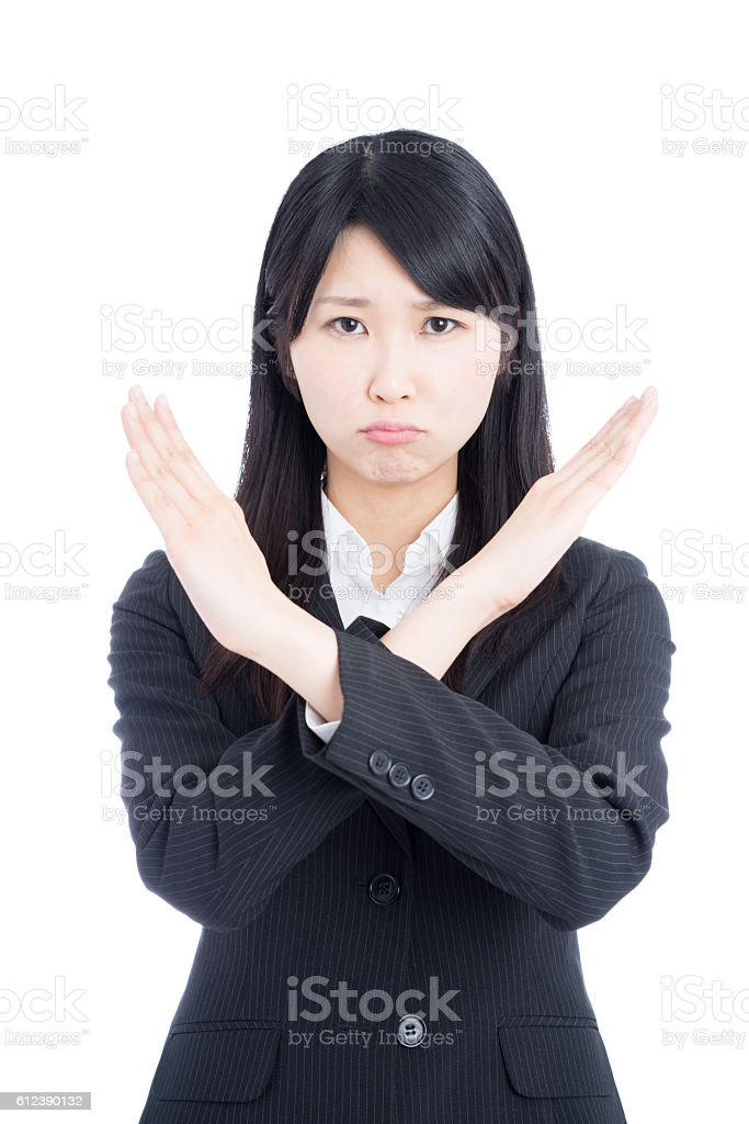 Businesswoman making x sign stock photo