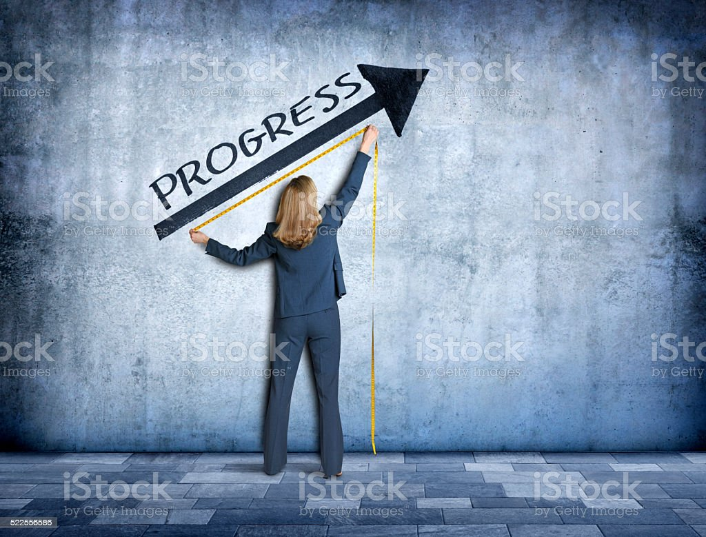 Businesswoman Measuring Progress stock photo