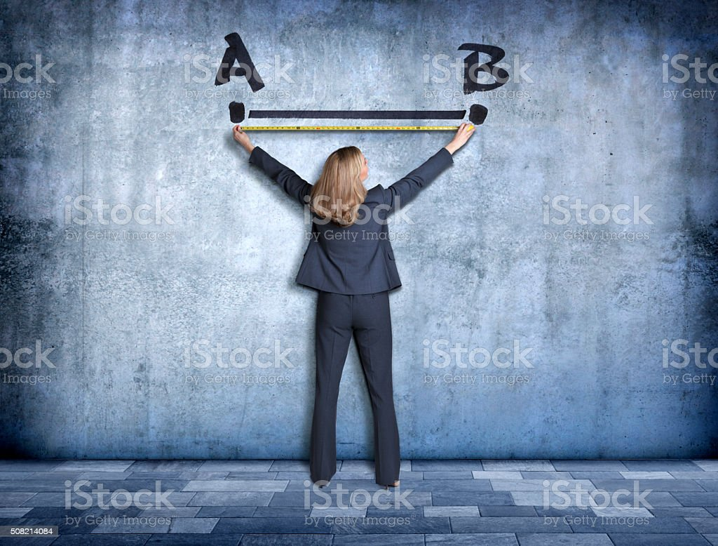 Businesswoman Measuring The Shortest Distance Between Two Points stock photo