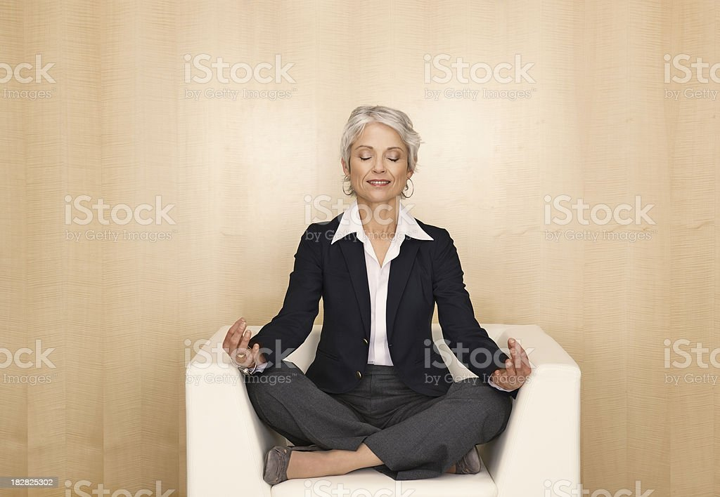 Businesswoman meditating royalty-free stock photo