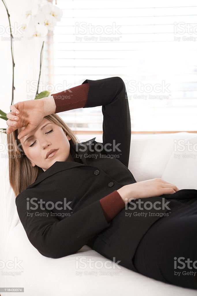 Businesswoman napping on the sofa royalty-free stock photo