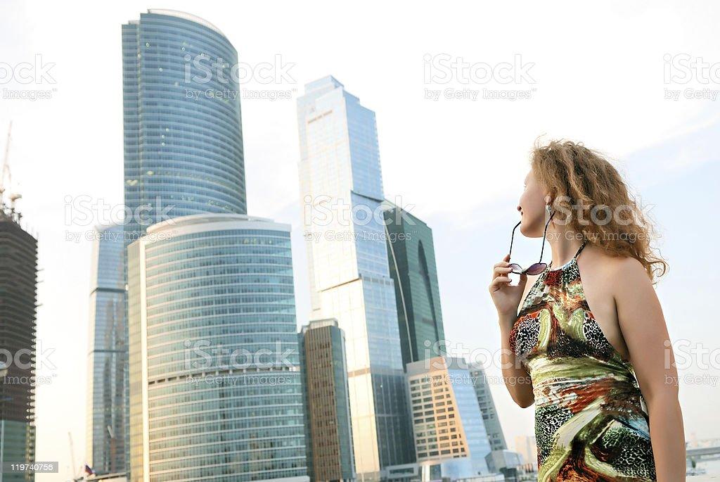 Businesswoman near modern buildings stock photo