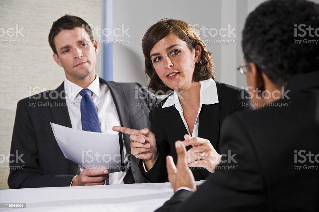 Businesswoman negotiating with men stock photo