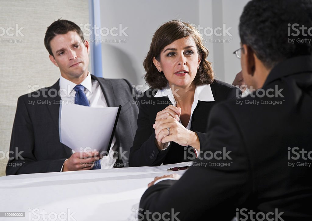 Businesswoman negotiating with men royalty-free stock photo