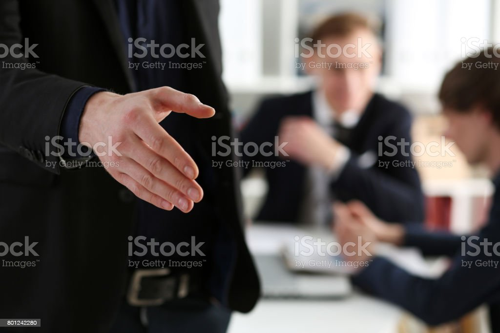 Businesswoman offer hand to shake as hello in office closeup stock photo