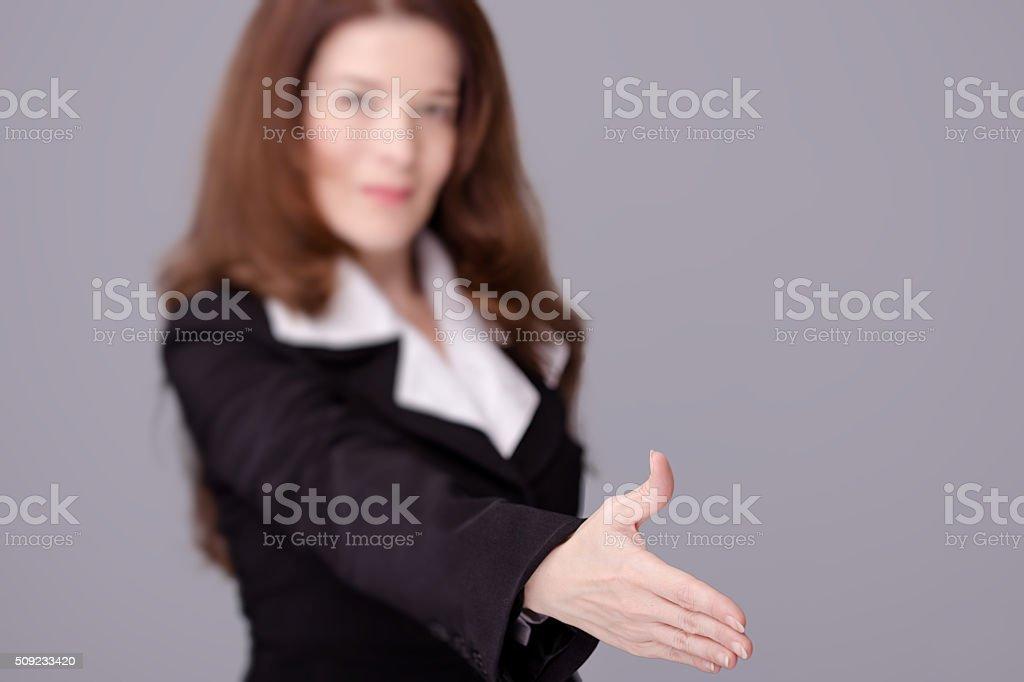 Businesswoman Offering a Handshake. stock photo