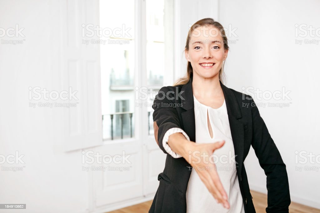Businesswoman offering hand royalty-free stock photo