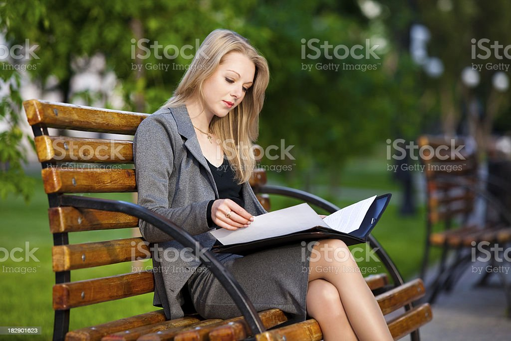 Businesswoman on a bench royalty-free stock photo