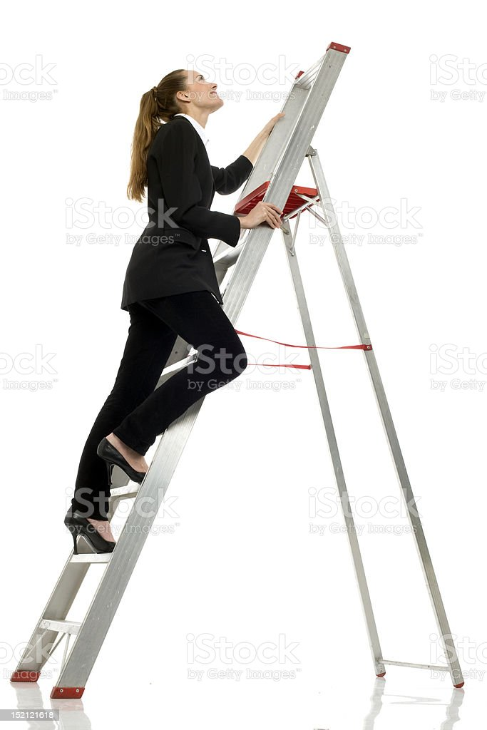 businesswoman on a ladder royalty-free stock photo