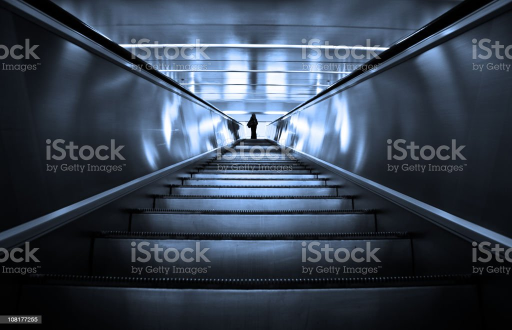 Businesswoman on a modern escalator royalty-free stock photo