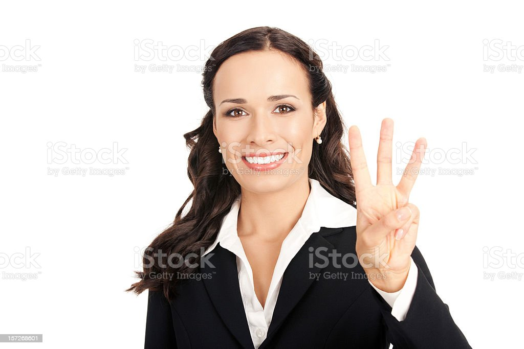 Businesswoman on a white background holding up three fingers stock photo
