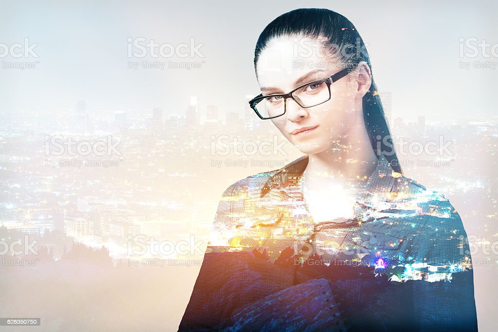 Businesswoman on abstract city background stock photo