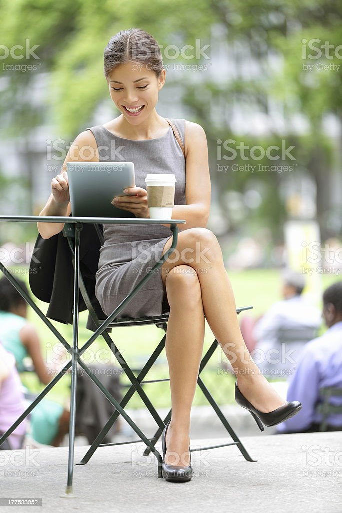 \'Businesswoman on break in park. Young professional business xwoman...
