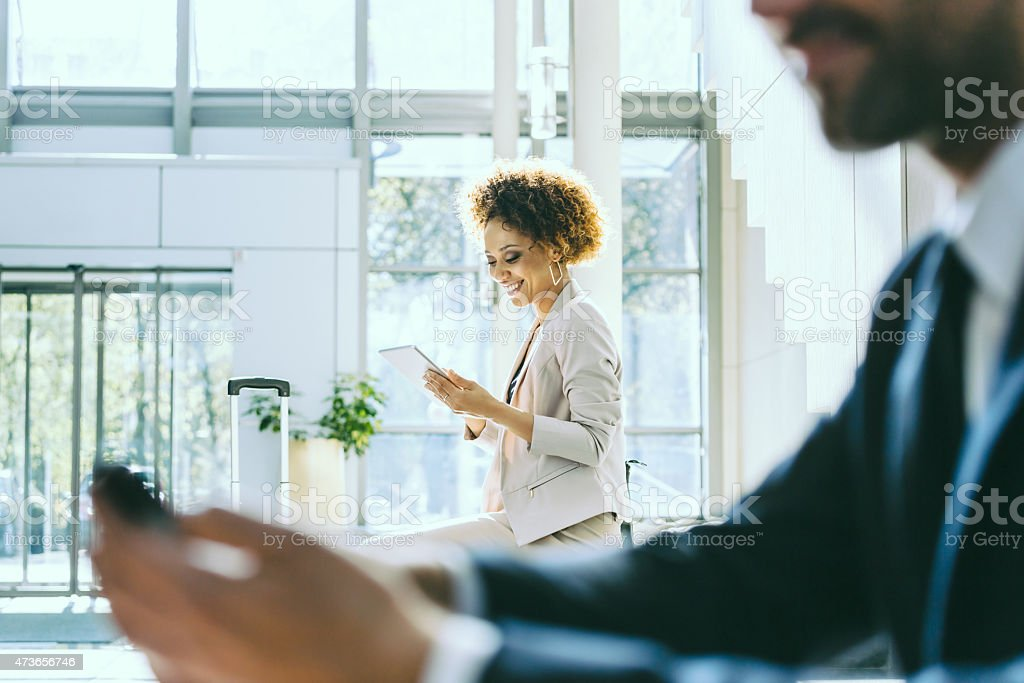Businesswoman on business travel using digital tablet in hotel stock photo