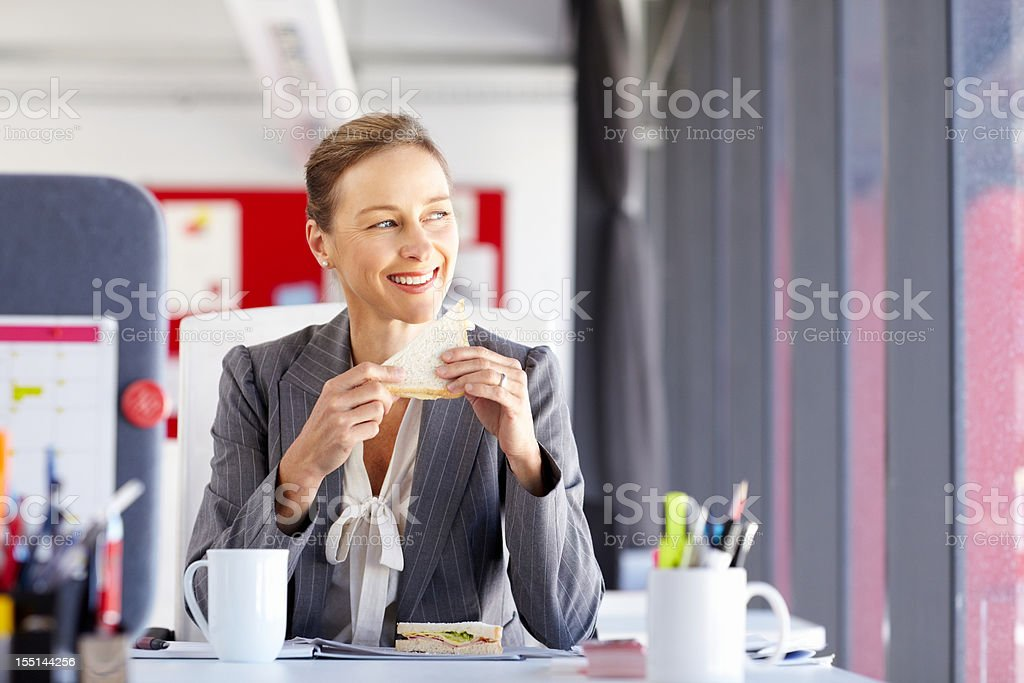Businesswoman on Her Lunch Break royalty-free stock photo