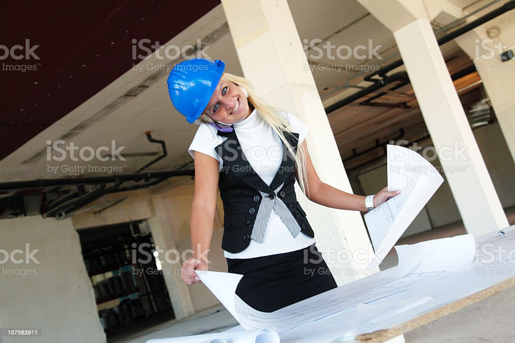 Businesswoman on phone at construction site royalty-free stock photo