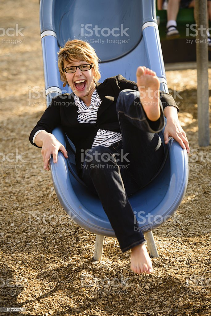 Businesswoman On Slide stock photo