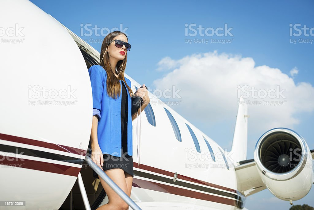 Businesswoman on the airplane exit royalty-free stock photo