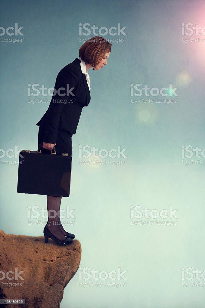 businesswoman on the edge stock photo