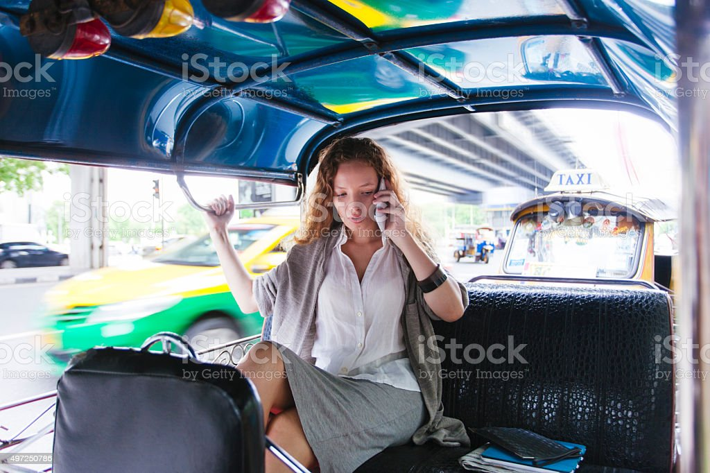 Businesswoman on the go in the streets of Bangkok. stock photo