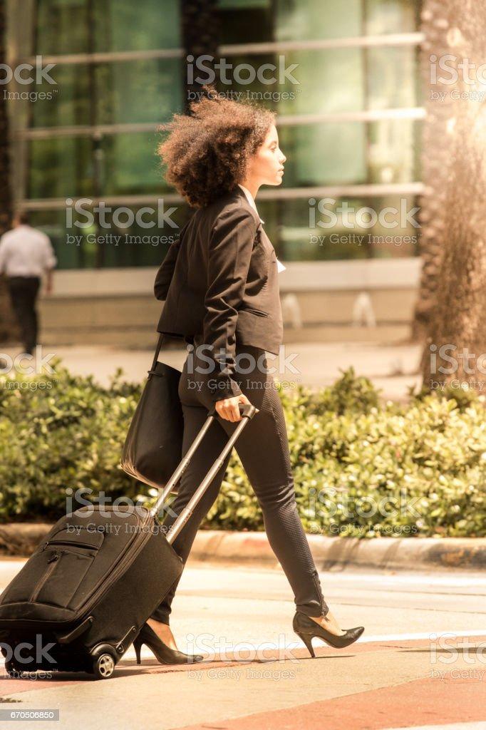 Businesswoman on the go stock photo
