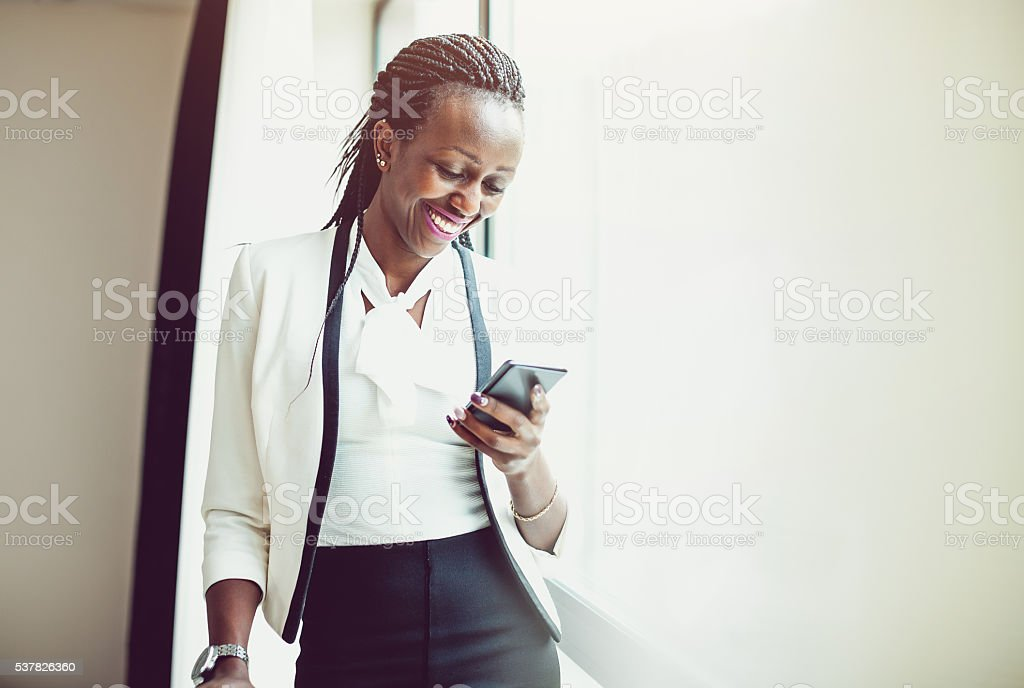 Businesswoman on the phone at the hotel room stock photo