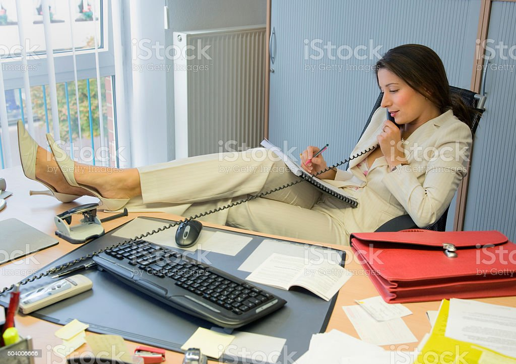 Businesswoman on the phone in office stock photo