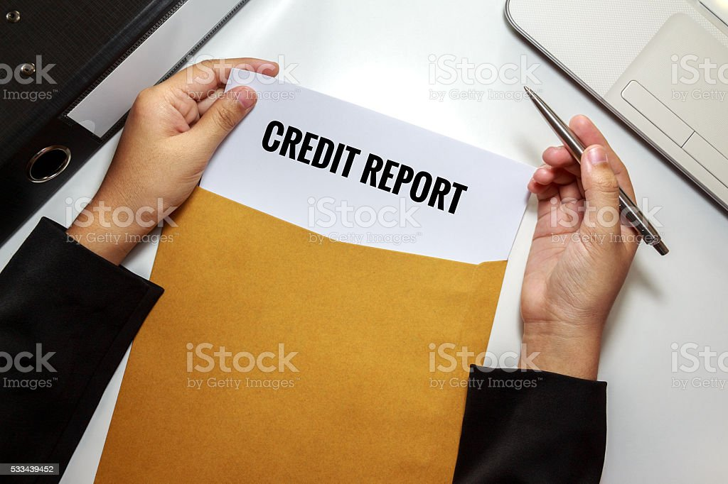 Businesswoman opening Credit report document in letter envelope stock photo