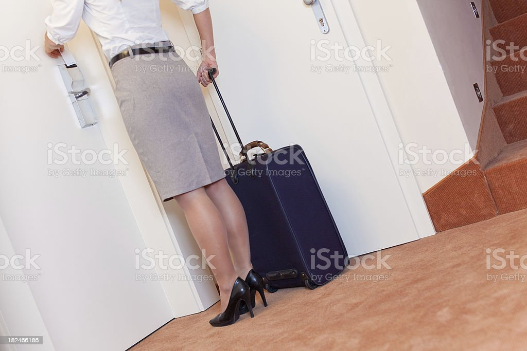 Businesswoman opening door of a hotel room royalty-free stock photo