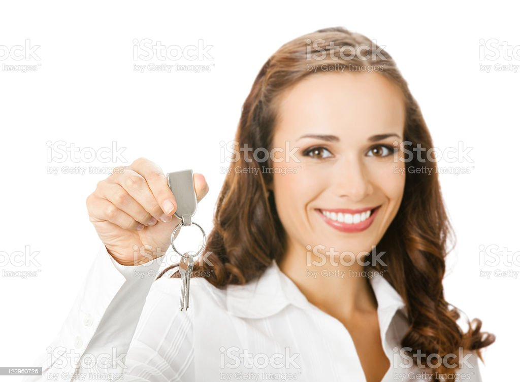 Businesswoman or real estate agent showing keys, isolated royalty-free stock photo