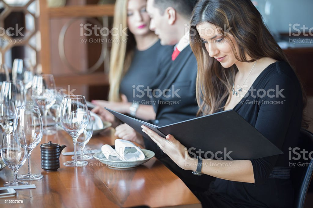 Businesswoman ordering meal in restaurant stock photo