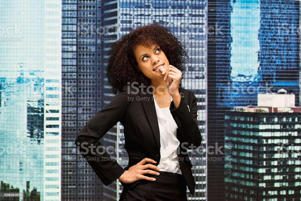 Businesswoman outdoor and thinking stock photo