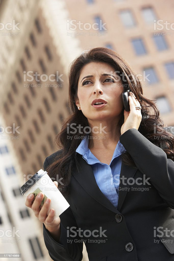 Businesswoman Outside Office On Mobile Phone royalty-free stock photo
