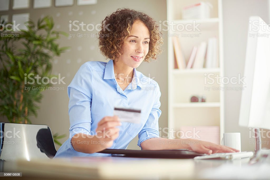 businesswoman paying online stock photo