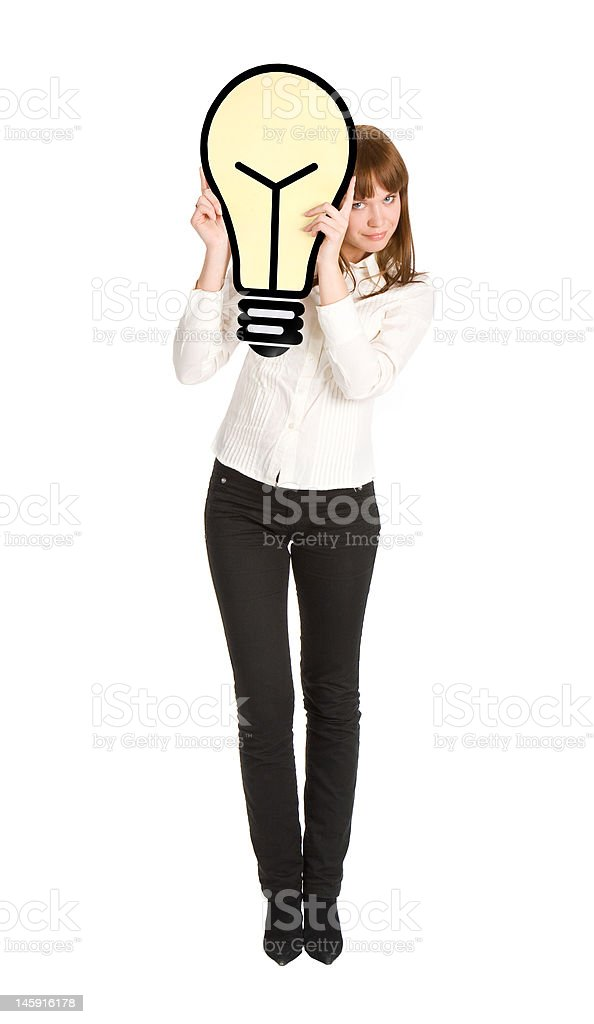 businesswoman peering from light bulb royalty-free stock photo