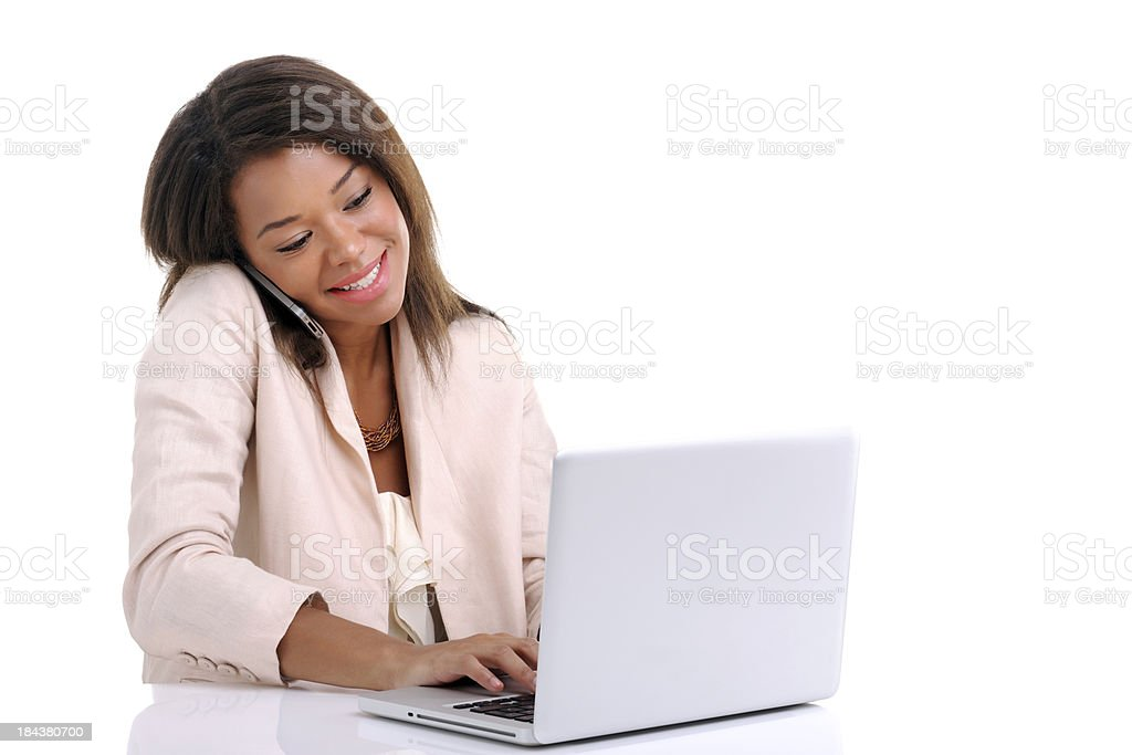 Businesswoman phoning and working with laptop royalty-free stock photo