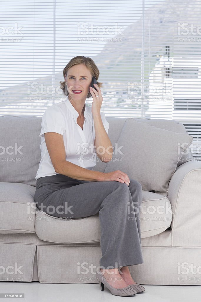 Businesswoman phoning in the office royalty-free stock photo