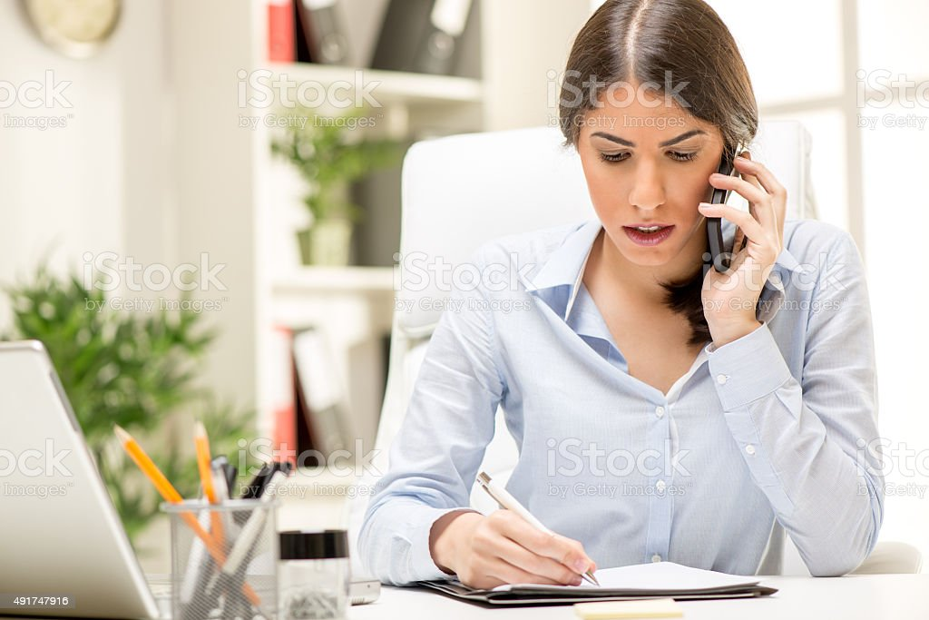 Businesswoman Phoning In The Office stock photo