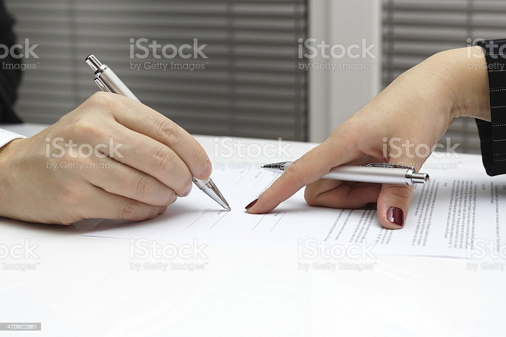 businesswoman point with finger on paper to sign up contract stock photo