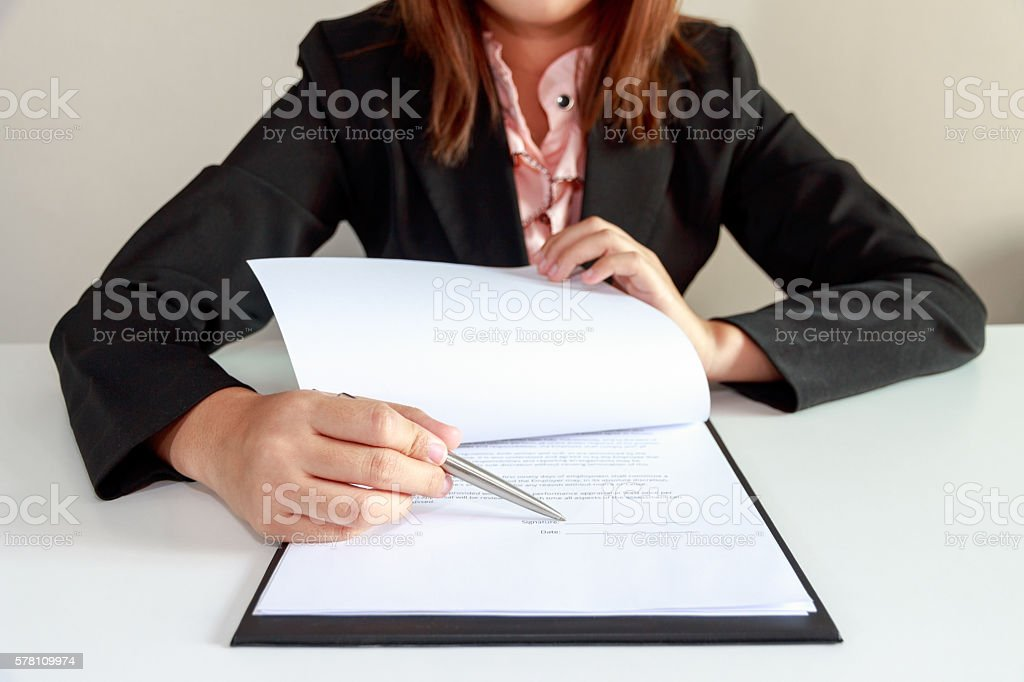 businesswoman pointing a place where should sign the contract stock photo