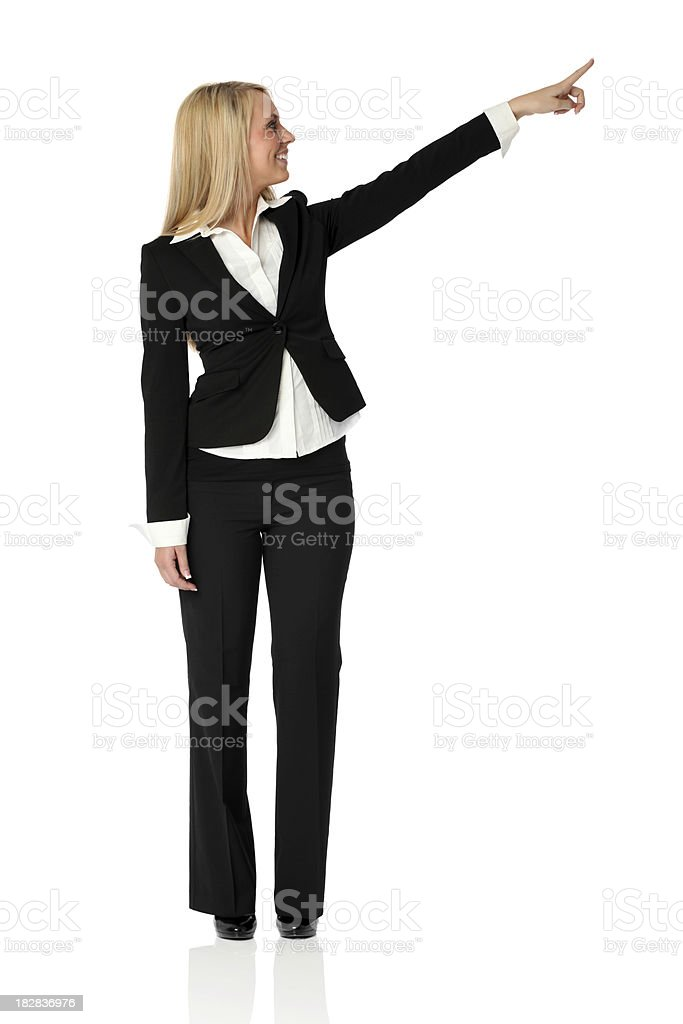 Businesswoman pointing against white background royalty-free stock photo