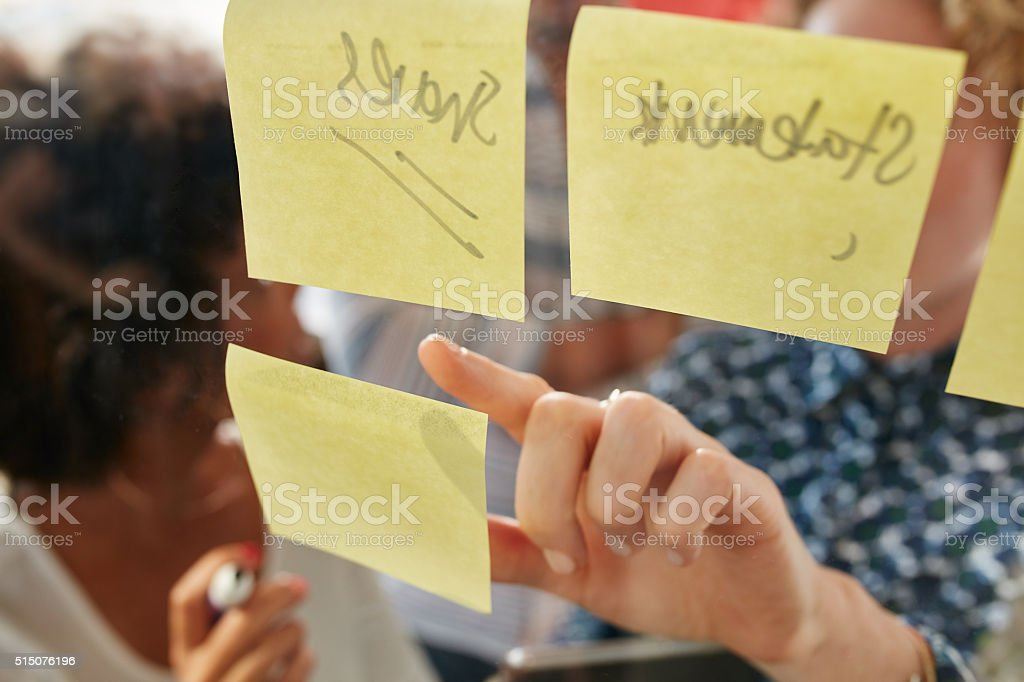 Businesswoman pointing at a sticky note stock photo