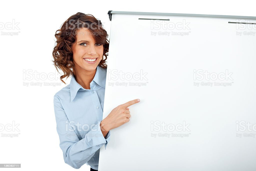 A businesswoman pointing at a white board on white royalty-free stock photo