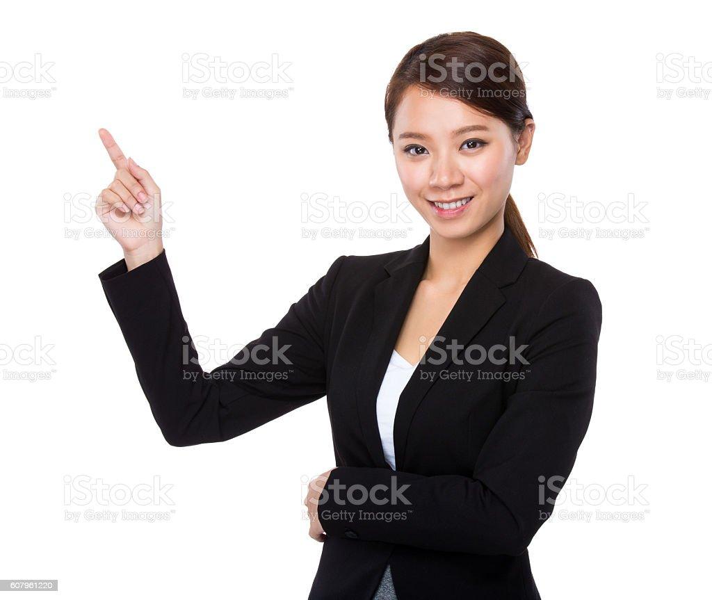 Businesswoman pointing stock photo