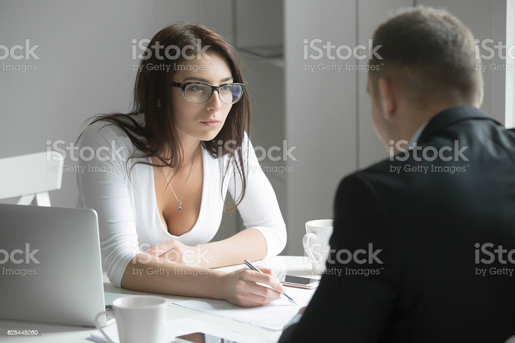 Businesswoman pointing to a mistake in a paper stock photo