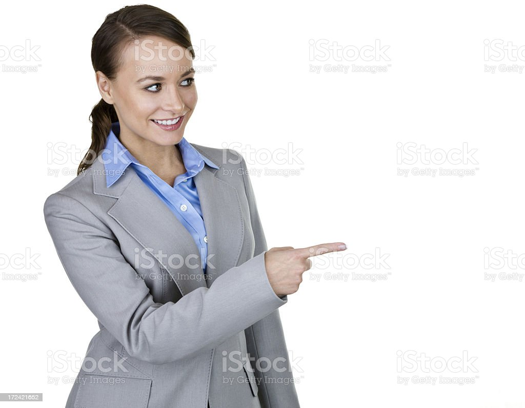Businesswoman pointing to copy space royalty-free stock photo