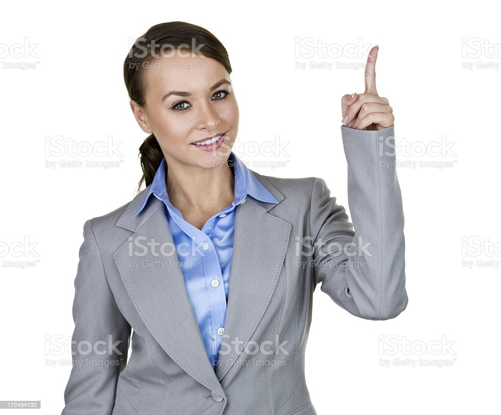 Businesswoman pointing up royalty-free stock photo
