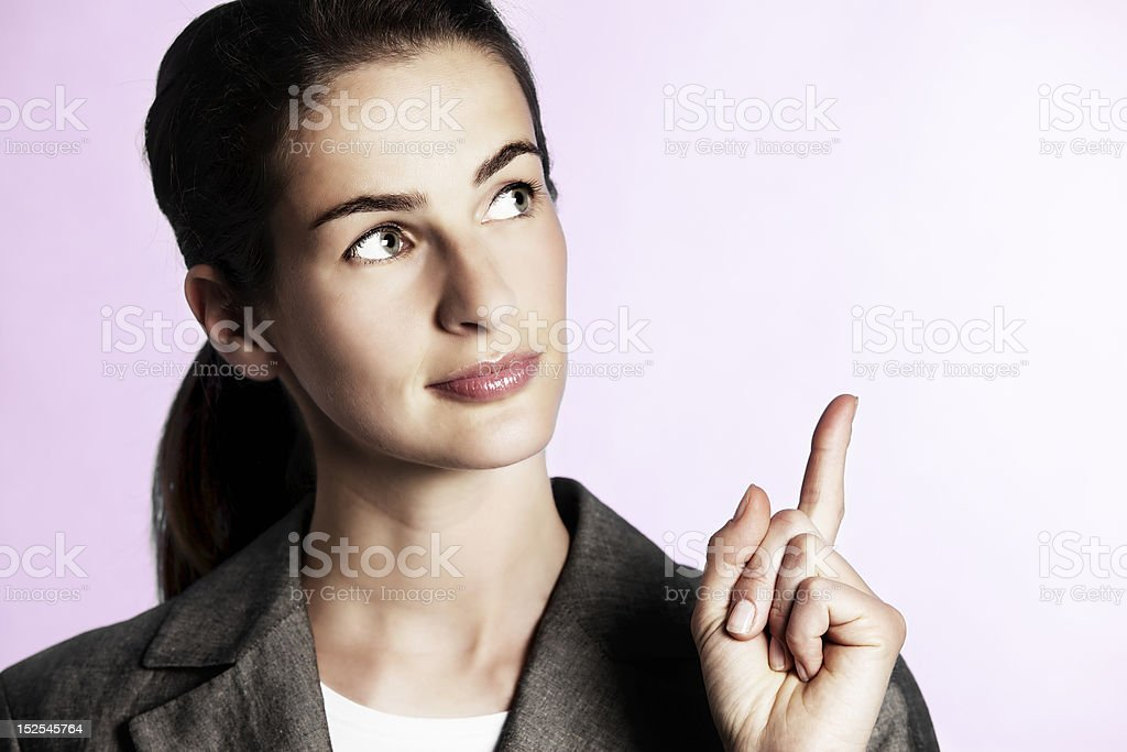 Businesswoman pointing upwards. royalty-free stock photo