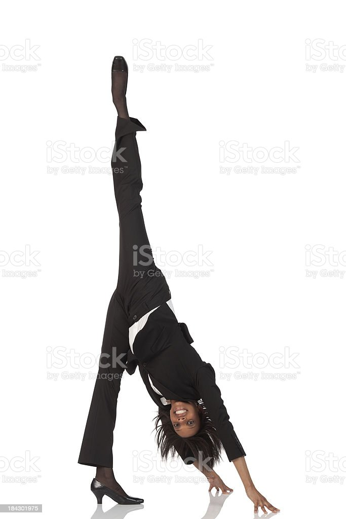 Businesswoman practicing standing splits exercise royalty-free stock photo